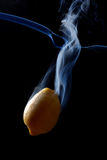 Yellow lemon and smoke Stock Image