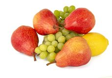 Yellow lemon and some bright appetizing tasty red pears with a bunch of green grapes stock photography