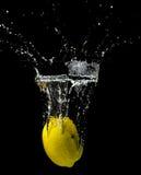 Yellow Lemon Submerged in Water Stock Image