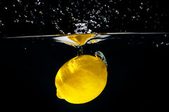 Yellow lemon in water splash Stock Photography