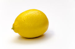 Yellow Lemon  on White. A yellow lemon  on a white background with shadow Royalty Free Stock Photography