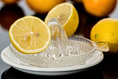 Yellow Lemonade on Clear Glass Saucer Stock Photos