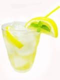 Yellow lemonade with ice and lemon Royalty Free Stock Photo