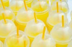 Yellow lemonade plastic cups royalty free stock photos