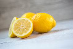 Yellow lemons. Cut and whole royalty free stock photos
