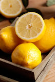 Yellow lemons organic. Yellow lemons of Sorrento organic on the wooden table stock photography
