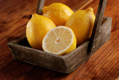 Yellow lemons organic. Yellow lemons of Sorrento organic on the wooden table stock image