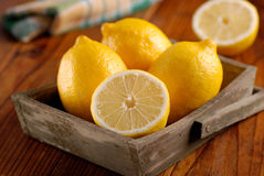 Yellow lemons organic. Yellow lemons of Sorrento organic on the wooden table royalty free stock photography