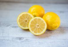 Yellow lemons. Three yellow lemons on table Stock Images