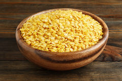 Yellow lentil in a wooden bowl Stock Image
