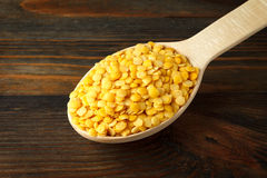 Yellow lentil in a wooden spoon Royalty Free Stock Image