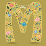 Yellow Letter M with Floral Decor and Necklace Stock Images