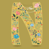 Yellow Letter N with Floral Decor and Necklace Royalty Free Stock Photo