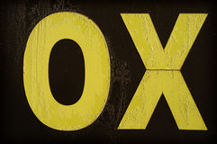 Yellow letter OX covered with frost Royalty Free Stock Images