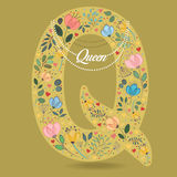 Yellow Letter Q with Floral Decor and Necklace Royalty Free Stock Photo