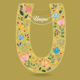 Yellow Letter U with Floral Decor and Necklace royalty free stock photos