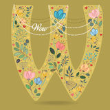 Yellow Letter W with Floral Decor and Necklace stock image