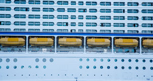 Yellow Life Boats Between Balconies and Portholes Stock Photography