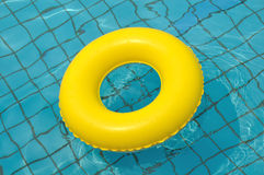 Yellow life buoy. Floating in water Stock Images