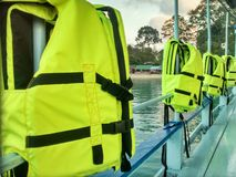Yellow Life Jackets On Ferry. Yellow life vests hanging on a boat royalty free stock image