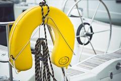 Yellow life jackets. A modern sailing ship yellow life jackets royalty free stock images