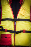 Yellow life vest. Close up image of a yellow life vest Stock Image
