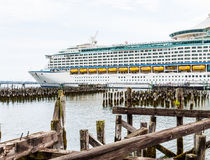 Yellow Lifeboats on Cruise Ship Past Wood Pilings Stock Photography