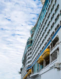 Yellow Lifeboats on Side of Cruise Ship. Side of massive luxury cruise ship with yellow lifeboats Stock Photos