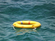 Yellow lifebuoy in Red Sea. Lifebuoy in sea may save your life Stock Photography