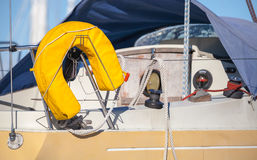 Yellow lifebuoy on yacht Royalty Free Stock Images