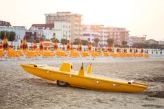 Yellow lifeguard boat on beach Royalty Free Stock Photo