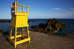 Yellow lifeguard chair cabin  in spain  lanzarote  rock stone sk Royalty Free Stock Photo