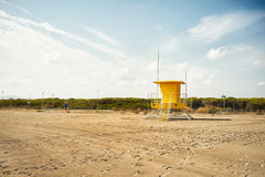 Yellow lifeguard post on an empty beach Stock Images