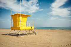 Yellow lifeguard post on an empty beach Stock Photo