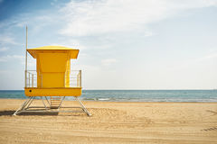 Yellow lifeguard post on an empty beach royalty free stock photo