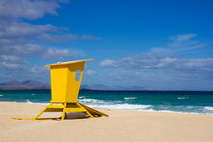 Yellow lifeguard tower. One life guard together red flag on beach. Point of safe, surviving. Coastal view. Royalty Free Stock Photos