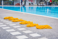 Yellow lifeline on the floor poo. L swimming Royalty Free Stock Photo