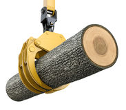 Yellow lifting crane with gripping claw holding oak tree Royalty Free Stock Photo