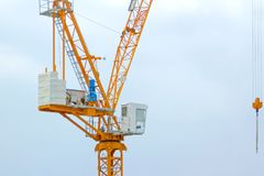 Yellow lifting crane Prepare to start In blue sky Stock Photography