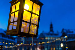 Yellow light on the background of the old town and blue sky Royalty Free Stock Photo