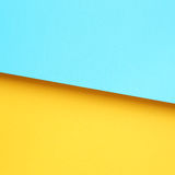 Yellow and light blue paper. Background Stock Image