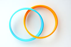 Yellow and light blue rubber bracelet. Royalty Free Stock Photography