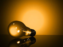 Yellow light bulb Royalty Free Stock Images