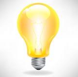 Yellow light bulb. Single glowing yellow light bulb Royalty Free Stock Photography