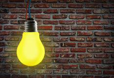 Yellow light bulb. Royalty Free Stock Photography