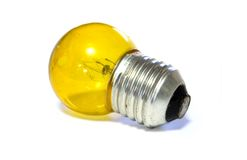 Yellow light bulb. Over white background Stock Images