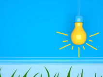 Yellow light bulb on blue background. Royalty Free Stock Photos