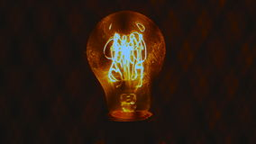 Yellow light bulb with long filament. It glows warm, soft light. Her thread is very long. The camera runs from top to bottom stopping at the level of the lamp stock footage