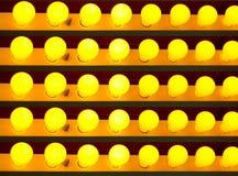 Yellow light bulbs. Multiple yellow light bulbs Stock Photography