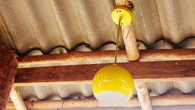 Yellow light bulb on the ceiling royalty free stock photo